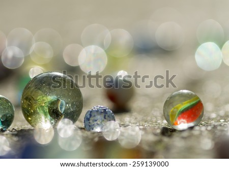 marbles,in the sun, blurry. Closeup, macro Picture taken out on the street. - stock photo