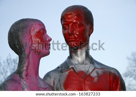 MARCH 2008 - BERLIN: a sculpture showing a couple, vandalized with grafitties in Berlin-Friedrichshain.