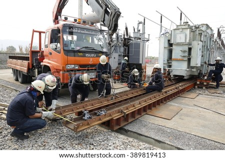 MARCH 7, 2016 ; LOP BURI - THAILAND : Workers are preparing the process of moving the old transformers are large, high-voltage station.