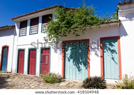 MARCH 27 - PARATY: Typical historical buildings with colorful wooden doors and windows in the colonial downtown of Paraty, Rio de Janeiro, Brazil on March 27th, 2016. - stock photo