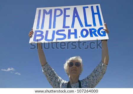 MARCH 2005 - Political rally with a sign reading Impeach Bush in Tucson, AZ - stock photo