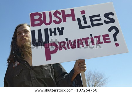 MARCH 2005 - Protestor in Tucson Arizona of President George W. Bush holding a sign protesting his Iraq foreign policy - stock photo