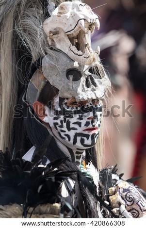March 4,2016, San Miguel de Allende, Mexico: an  indigenous man with painted face wearing a skull head dress at the Senior de la Conquista dance celebration - stock photo