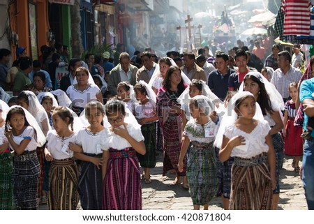 March 24, 2016 San Pedro la Laguna, Guatemala: girls dressed in traditional clothing children's procession during Easter Holy Week