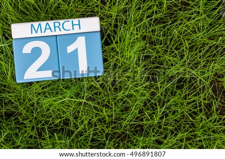 March 21st. Day 21 of month, calendar on football green grass background. Spring time, empty space for text