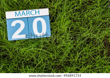 March 20th. Day 20 of month, calendar on football green grass background. Spring time, empty space for text