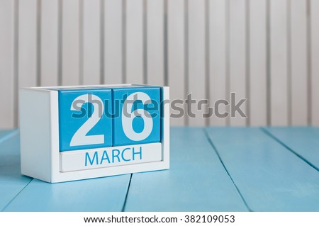March 26th. Image of march 26 wooden color calendar on white background.  Spring day, empty space for text. Purple DAy is the international day For epilepsy awareness.