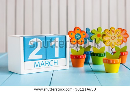 March 21th. Image of march 21 wooden color calendar with flower on white background.  Spring day - stock photo
