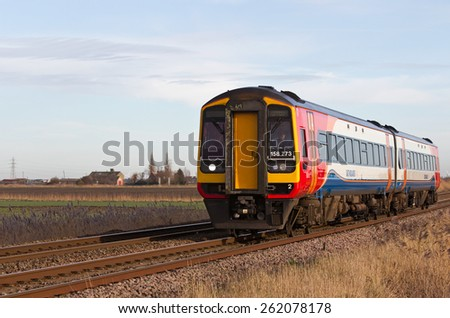 MARCH, UK - JANUARY 10: An East Mids operated commuter train service heads from March to Peterborough on January 10, 2014 in March. East Mids stop at 87 UK stations and operate over 1,568Km of track - stock photo