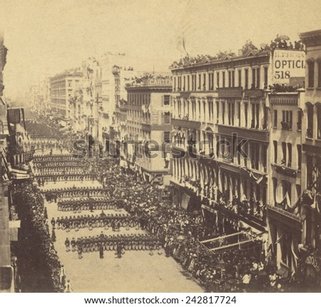 Marchers in Lincoln's New York funeral procession proceeding down Broadway away from the viewer ca. 1865. - stock photo