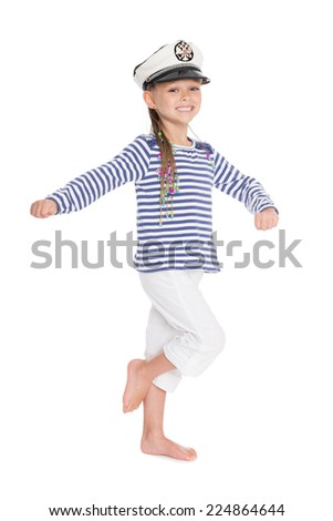 Marching mischievous girl in suite sailor boy. Cap has a emblem of Russia.Girl is six years old.  - stock photo