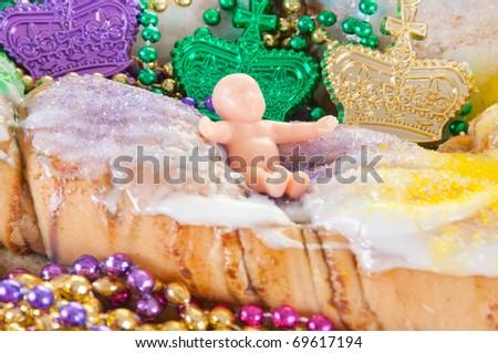 mardi gras cake  with beads - stock photo
