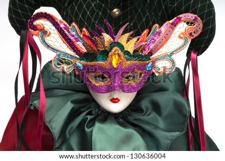 Mardi Gras clown with colorful masquerade mask isolated on white background - stock photo