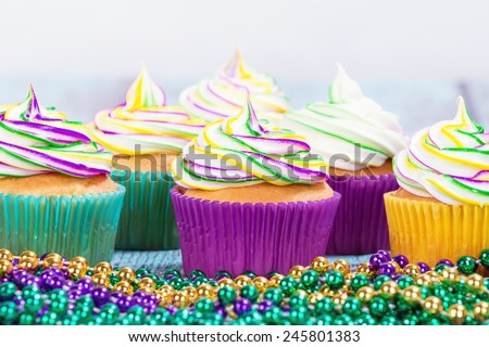 Mardi Gras cupcakes with beads, shallow depth of field