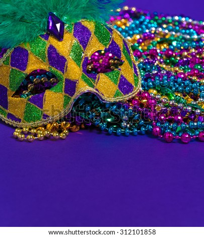Mardi Gras or carnival mask on bright purple background - stock photo