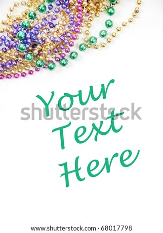 Mardi gras or holiday beads with copyspace - stock photo