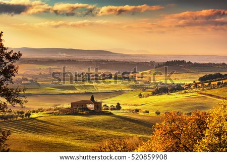 Maremma, rural sunrise landscape. Countryside farm and green fields. Elba island on horizon. Tuscany, Italy, Europe.