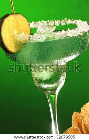 Margarita cocktail and tortilla chips close up - stock photo