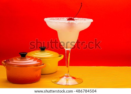 Margarita cocktail emphasizes the party atmosphere of Happy Hour in Mexican Bar and Restaurant .