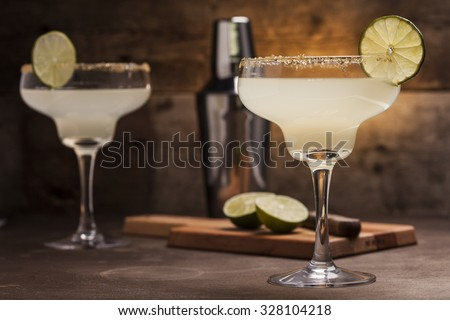 Margarita cocktail on a wooden background - stock photo