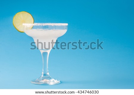 Margarita cocktail on blue background