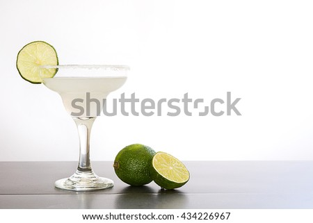 Margarita cocktail on slate table and white background