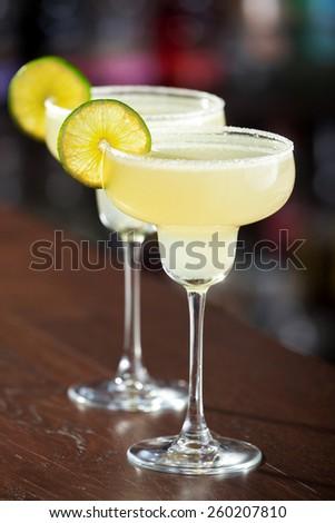 Margarita cocktail shot on a bar - stock photo