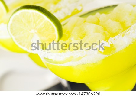Margarita cocktail with slice of lime as a garnish. - stock photo