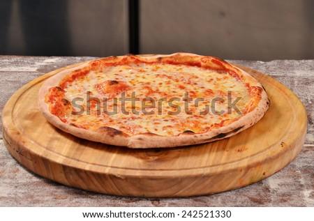 Margarita pizza on wood table. - stock photo