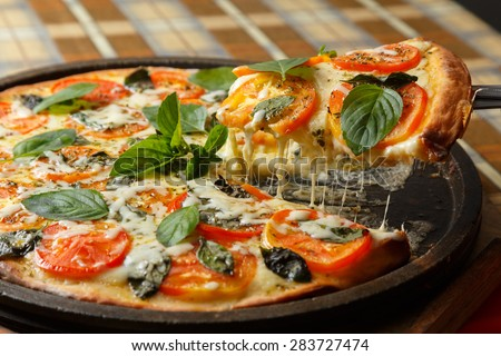 Margarita pizza with basil leaves - stock photo