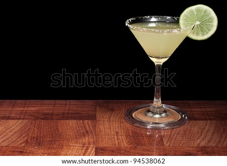 margarita served up on a bar top isolated on a black background - stock photo