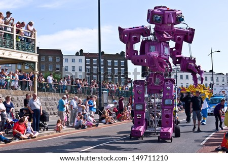 MARGATE, UK-AUGUST 4: Binbot mechanical sculpture made of wheelie bins ,part of Great British Carnival group,entertains the crowds at Margate's annual carnival. August 4, 2013 in Margate, UK - stock photo