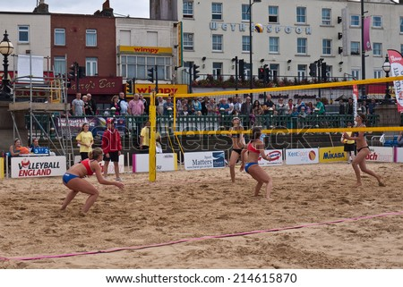 MARGATE,UK-AUGUST 16: Competitors play on Margate Main Sands for the finals of Volley Ball England Beach Tour. August 16, 2014 in Margate, UK. - stock photo