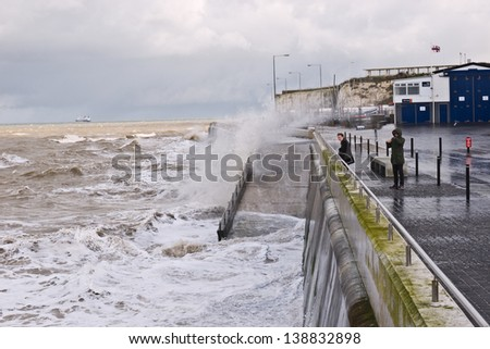 MARGATE,UK-FEBRUARY 2: Visitors get a wetting as stormy waves crash against the sea wall. Margate is one of Rough guides destinations for 2013 February 2, 2013 Margate UK - stock photo