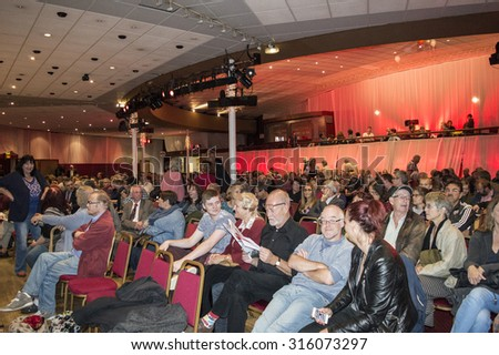 MARGATE, UK-SEPTEMBER 5: Members of the audience in the rally for Jeremy Corbyn's election to Labour party Leader, in Margate's Winter Garden. September 5, 2015, Margate, Kent UK.
