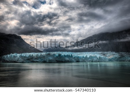 Margerie Glacier in Glacier Bay National Park and Preserve  in Alaska, USA on a cloudy summer day.