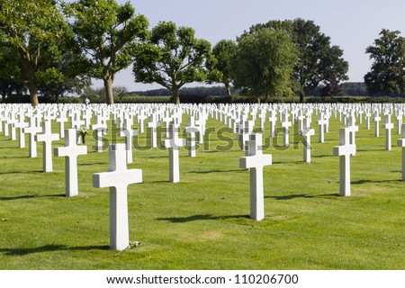 MARGRATEN - AUGUST 10: Crosses mark the graves of the more than 8000 soldiers whose remains have been buried at the American War Cemetery of Margraten in the Netherlands, on August 10, 2012.