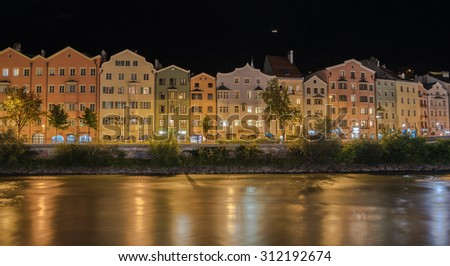MARIA HILFER-ST. NICOLAS District, INNSBRUCK, AUSTRIA-August 22, 2015: A row of colorful houses, apartments, offices, hotels, restaurants along the left bank of river Inn at night