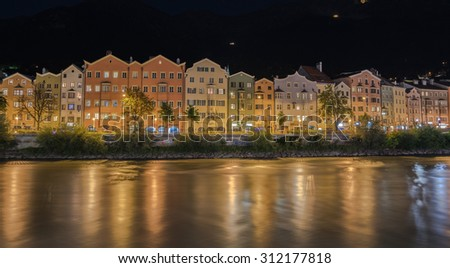 MARIA HILFER-ST. NICOLAS District, INNSBRUCK, AUSTRIA-August 22, 2015: A row of houses, apartments, offices, hotels, restaurants, along the left bank of river Inn at night