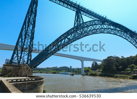 Maria Pia railway bridge (Ponte Maria Pia, built in 1877 by Gustave Eiffel) and St John's Bridge (construction in 1991 by Edgar Cardoso) above Douro river, Porto, Portugal.