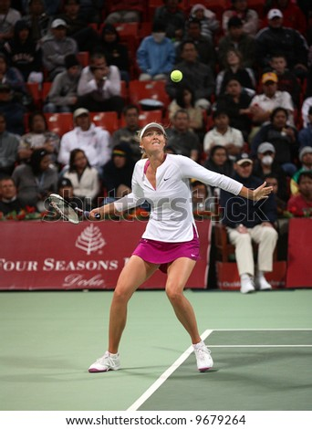 Maria Sharapova, world No.5, keeps her eyes on the ball during her match with fellow Russian Galina Voskoboeva, which she won by two sets to one. - stock photo
