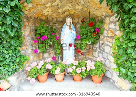 Maria statue in the countryside from Poland - stock photo