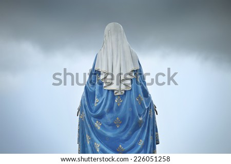 maria statue stand back side - stock photo