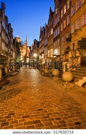 Mariacka Street at night in city of Gdansk in Poland, Old Town, historic burgher houses with perrons.