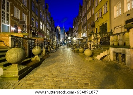 Mariacka Street - one of the most beautiful streets of the Old Town of Gdansk, Poland at night. St. Mary's Church in the end of the street