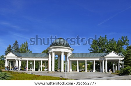 MARIANSKE LAZNE, CZECH REPUBLIC - AUGUST 26, 2015: Marianske Lazne Spa, Carolina's Spring pavilion and colonnade. Within the town and its surroundings rise around one hundread mineral springs