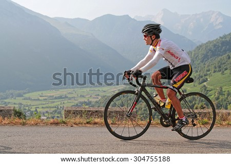 MARIE-BLANQUE, FRANCE, July 14, 2015 : Unidentified cyclo-tourist climbs the Marie-Blanque pass, in Pyrenees mountains.
