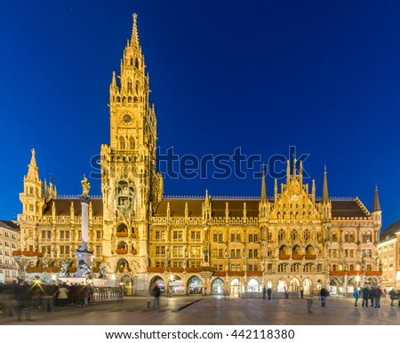 Marienplatz, Munich City Beautiful Panorama scenic skyline view Cityscape of Munchen night illuminated architecture under clear blue sky: New Town Hall and Frauenkirche at Night, Bavaria, Germany.  - stock photo