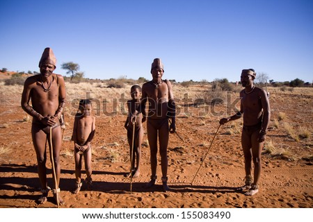 MARIENTAL, NAMIBIA - AUGUST 19: san people show people how they live in the kalahari desert in namibia august 19, 2013 in Mariental, Namibia - stock photo