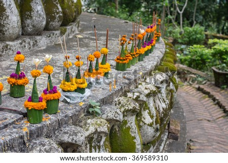 marigold flower prepare for respect Buddha at the temple in Laos, Culture in southeast Asia - stock photo